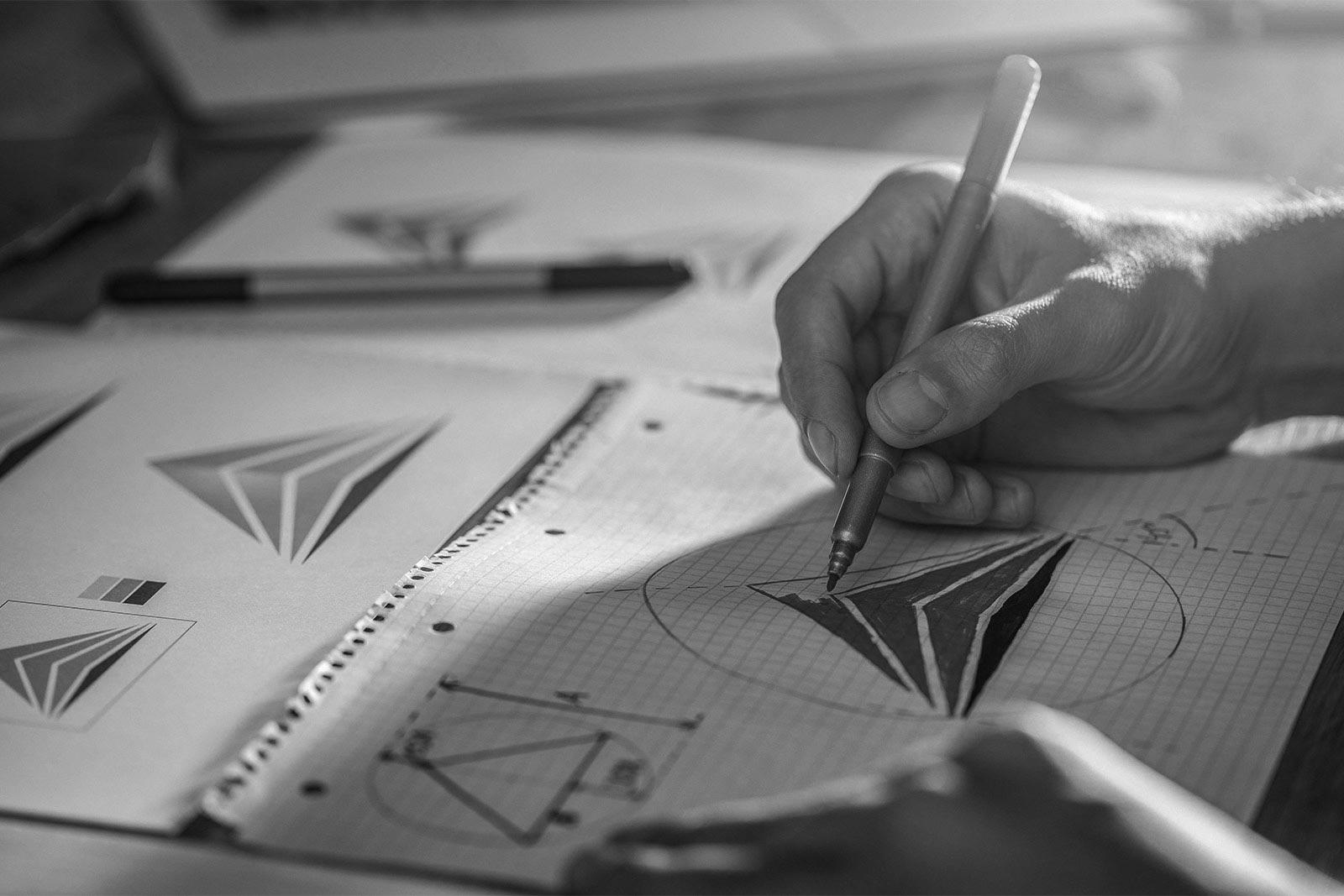 A graphic designer sketches out a logo design